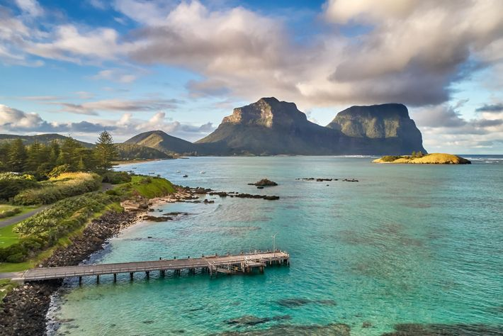 Mount Lidgbird rises over the lagoon at Lord Howe Island, Australia. Only 400 visitors are allowed ...