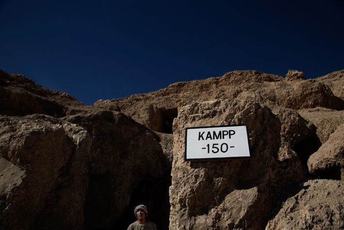An Egyptian guard monitors the entrance of a 3,500-year-old tomb where a mummy was recently discovered.