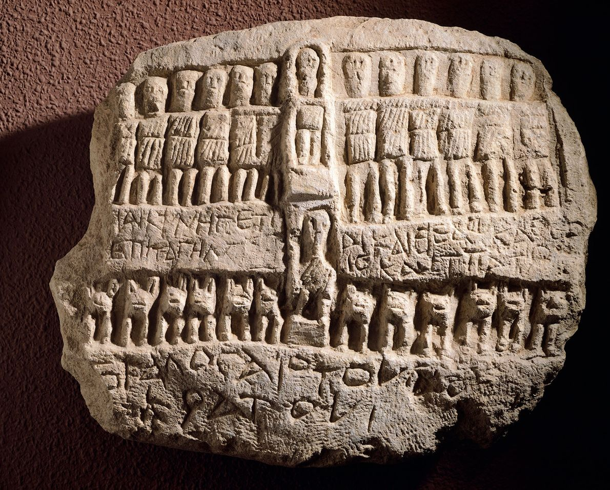 A plaque dedicated to Artemisia shows her surrounded by twelve gods.