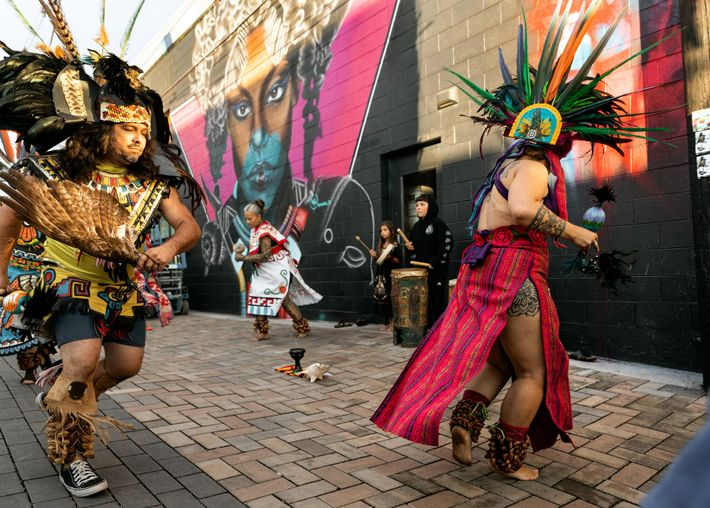 A group of traditional Aztec dancers perform during Crush Walls 2019, a popular street art festival ...