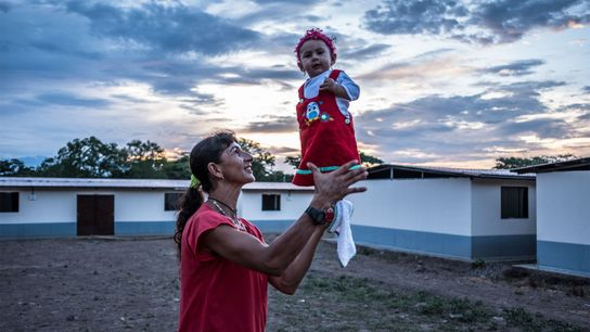 Former FARC fighter Esperanza Medina holds her seven-month-old daughter, Desiree Paz, at the transitional and normalization ...