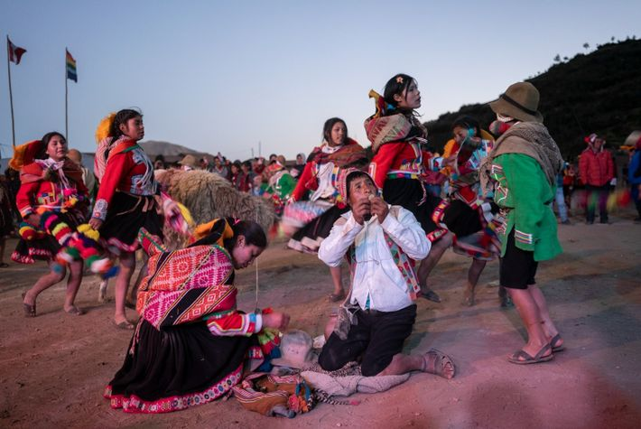 During the anniversary of the Huarahuara community, dancers made offerings to the pachamama to bless and ...