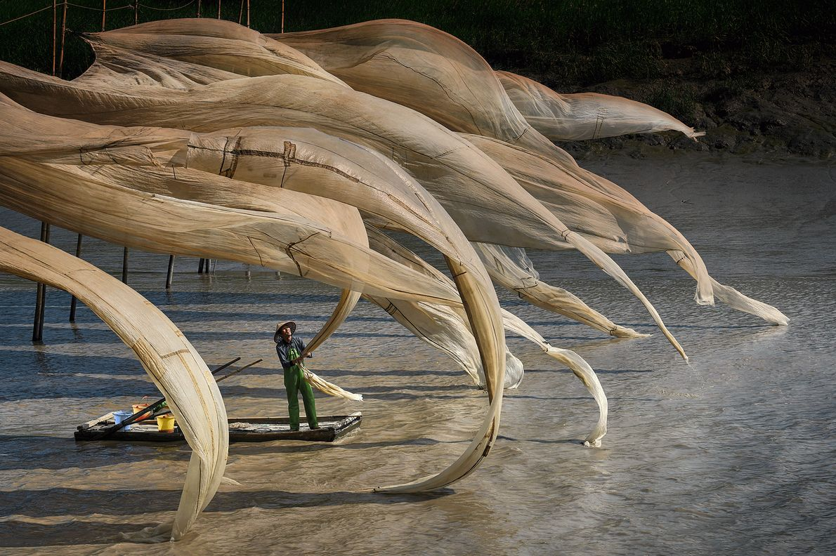 Picture of a fisherman's nets blowing in the wind in China