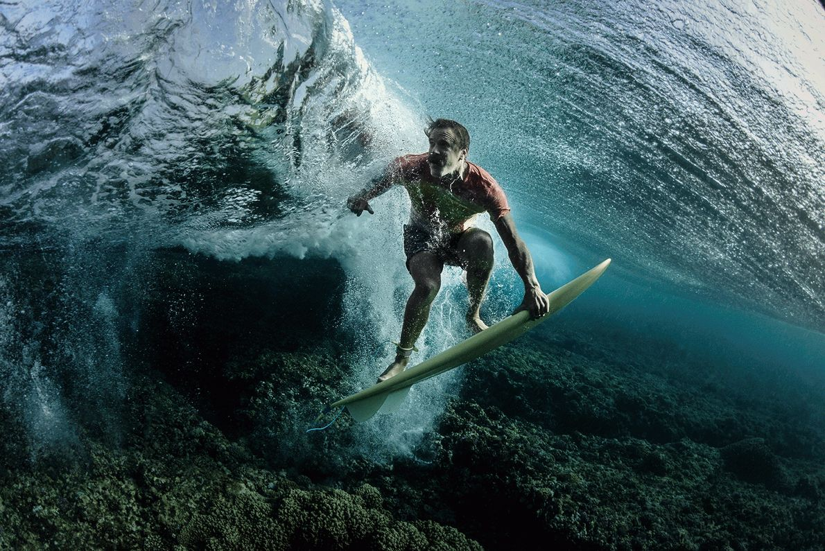 Picture of a surfer on his board underwater in Fiji