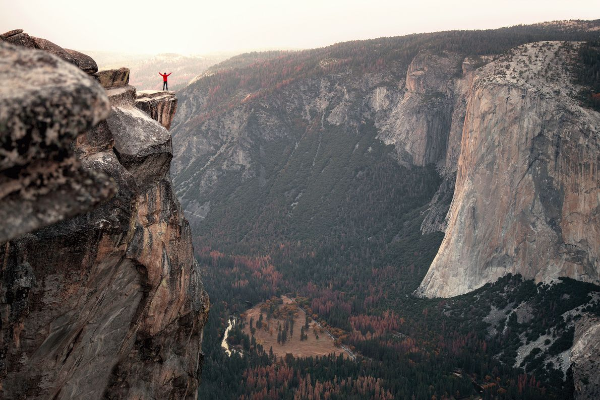 Picture of a hiker standing on a cliff in Yosemite Valley, California
