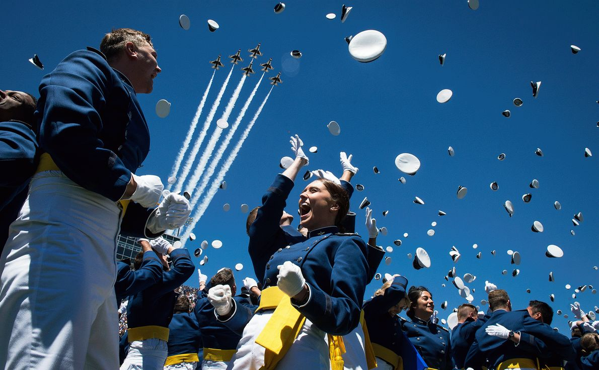Picture of Air Force cadets throwing caps into the air to celebrate graduation
