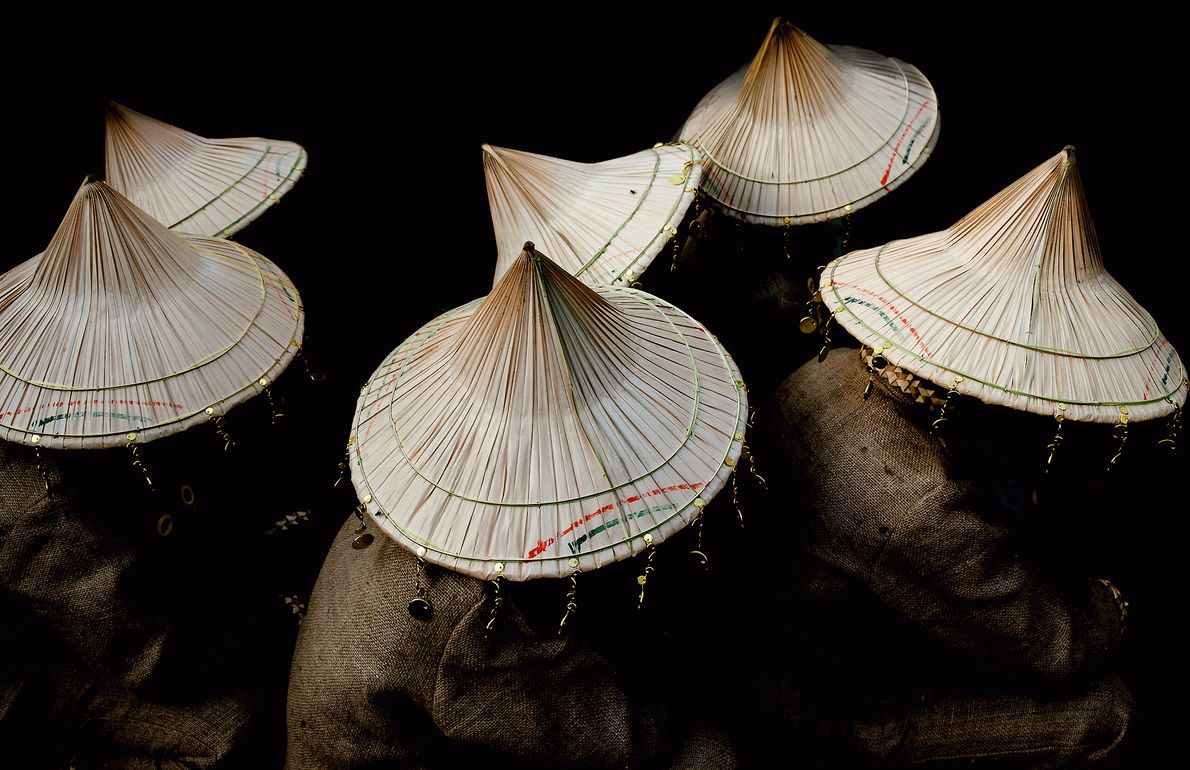 Picture of traditional hats on dancers during a coffee festival in the Philippines