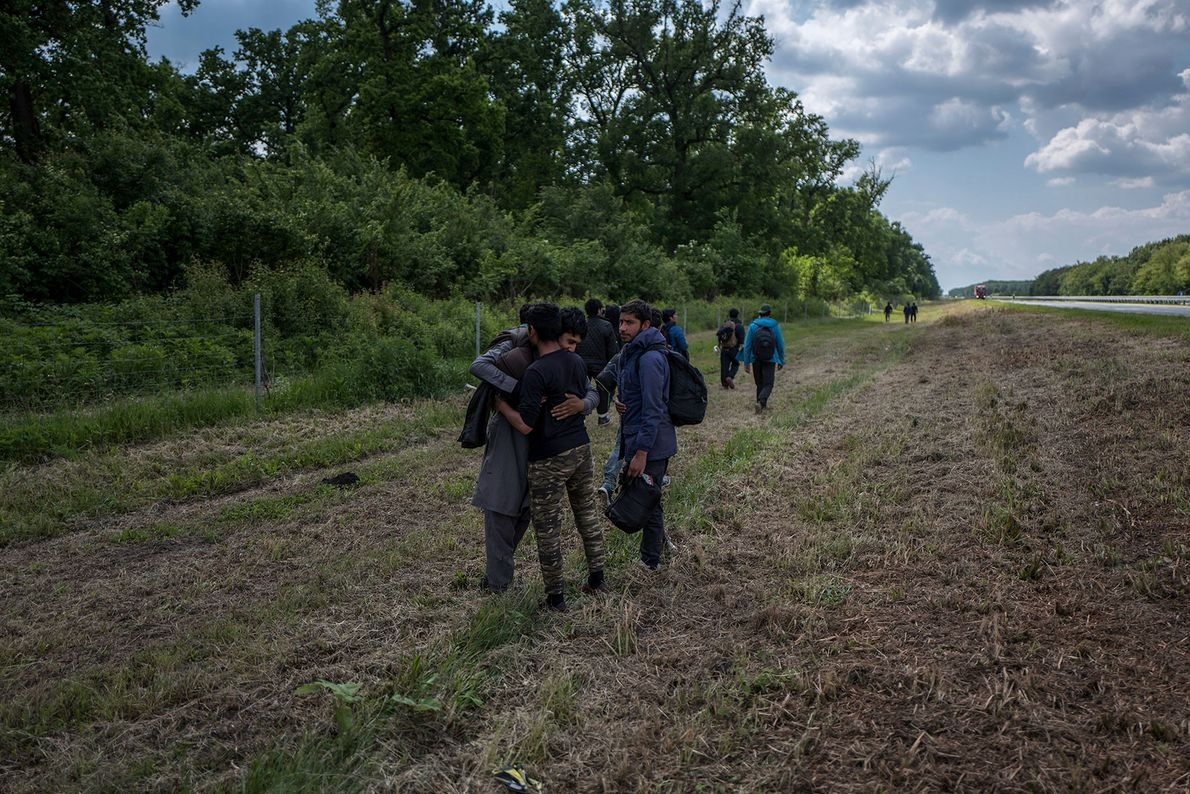 A group of refugees from Afghanistan, including children, head out to play what they call the ...