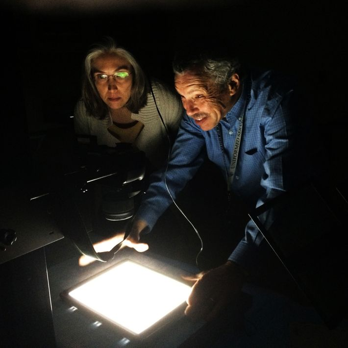 Neuropathologists Daniel Perl, right, and Sharon Shively, a co-author of the study on brain scarring, photograph ...
