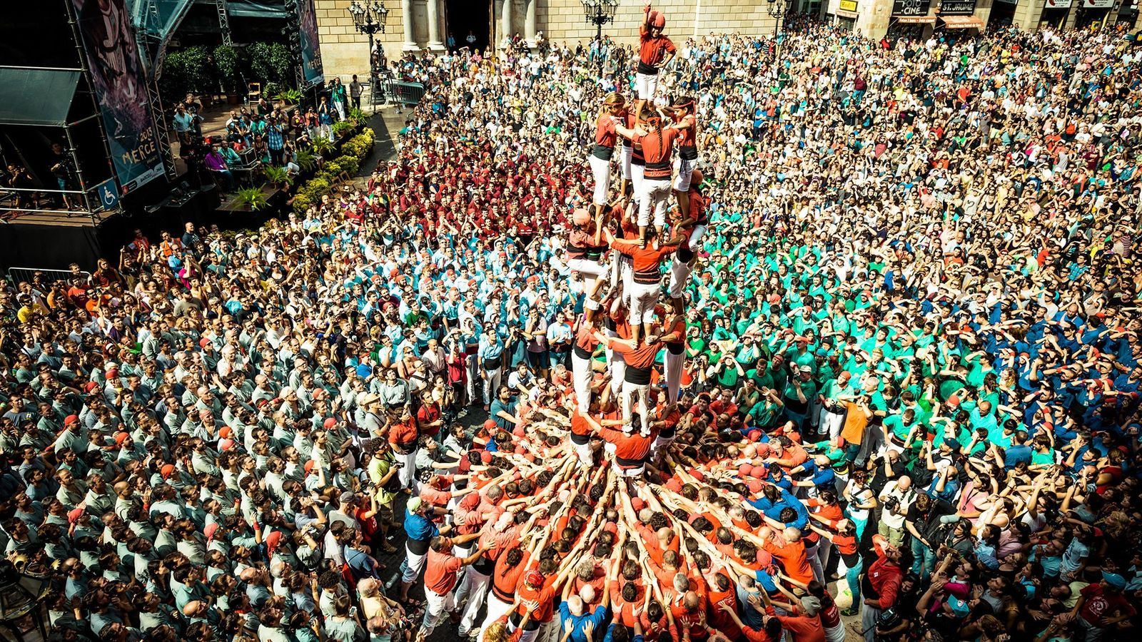 The castellers of Barcelona build a human tower in front of Barcelona's town hall during the ...