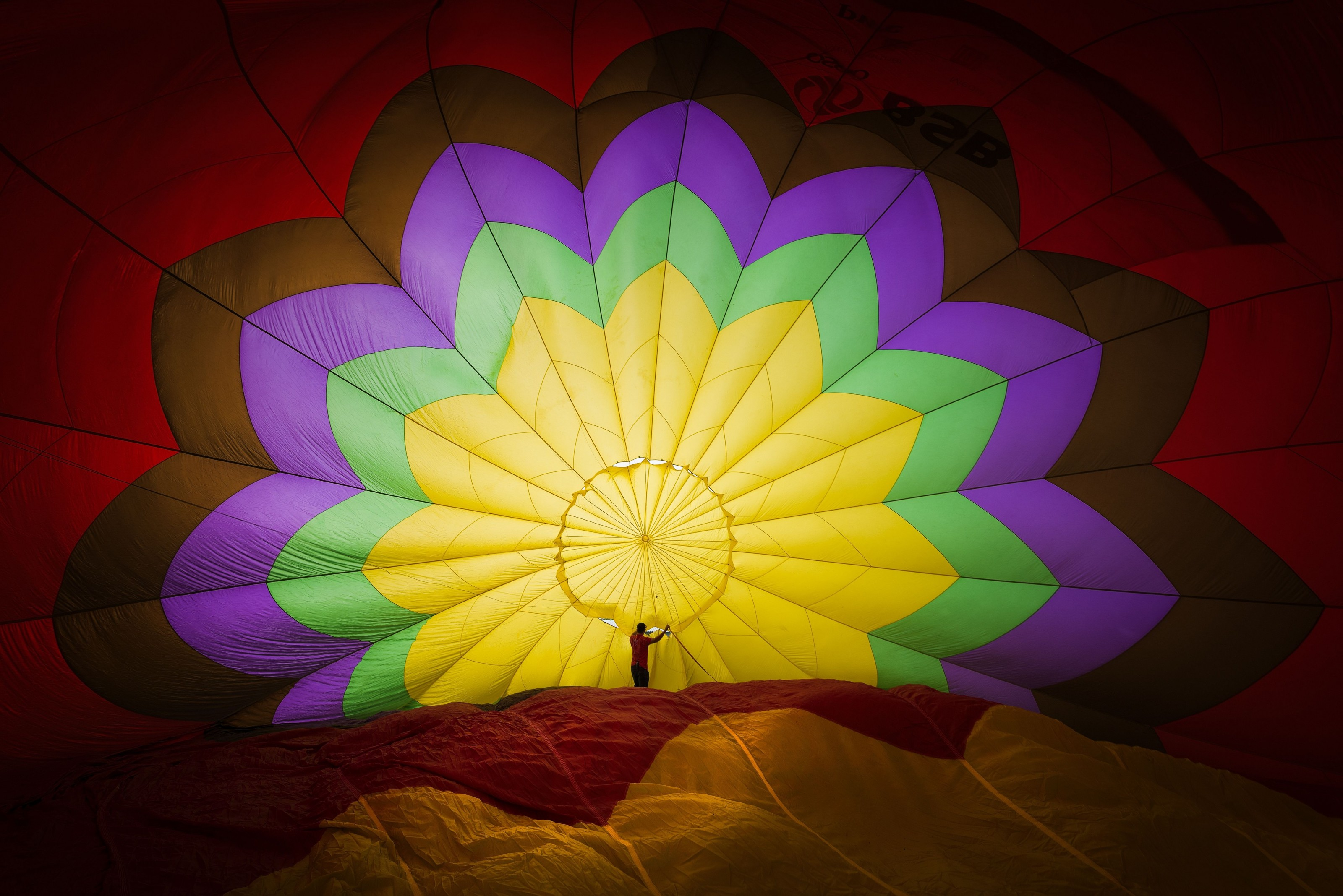 Picture of a man inside a deflated hot-air balloon in Vietnam