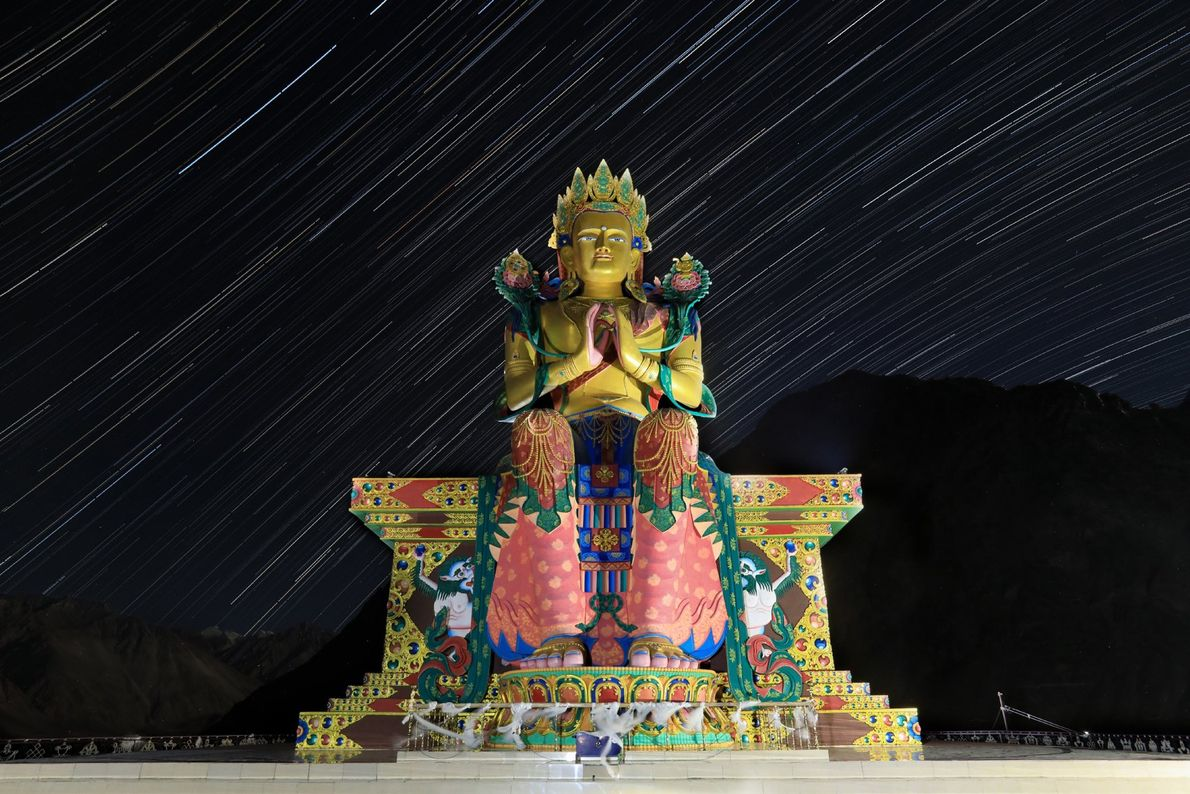 This star-streaked, 106-foot-high statue of Jampa Buddha sits atop Diskit monastery, the oldest and largest Buddhist ...