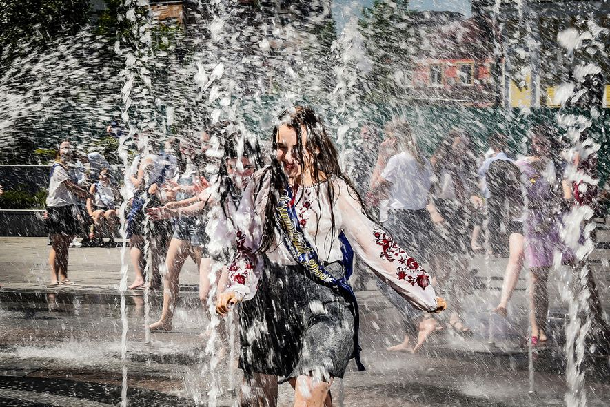 Running through the fountain, a student celebrates.
