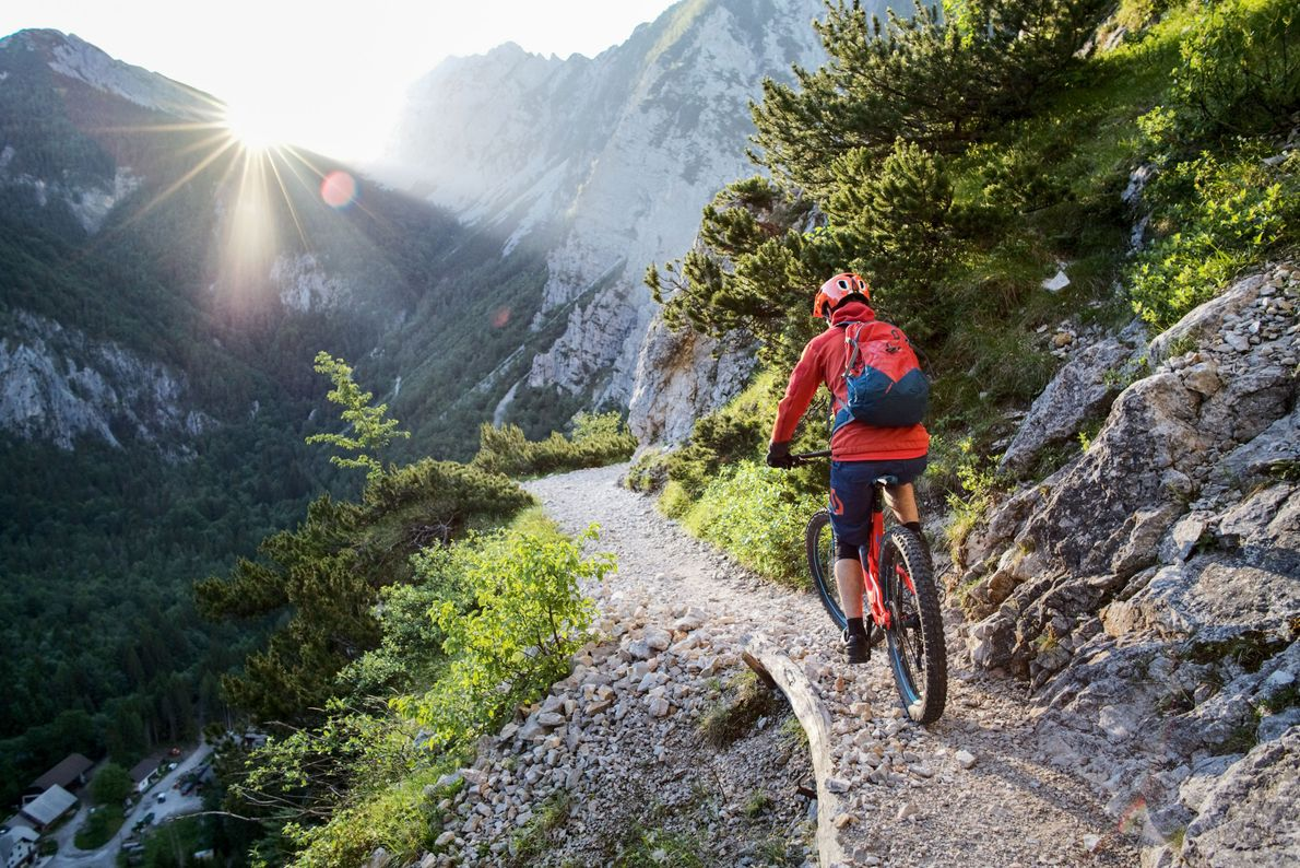 The sun peeks out from behind the mountains on the Born Trail, a route that leads ...