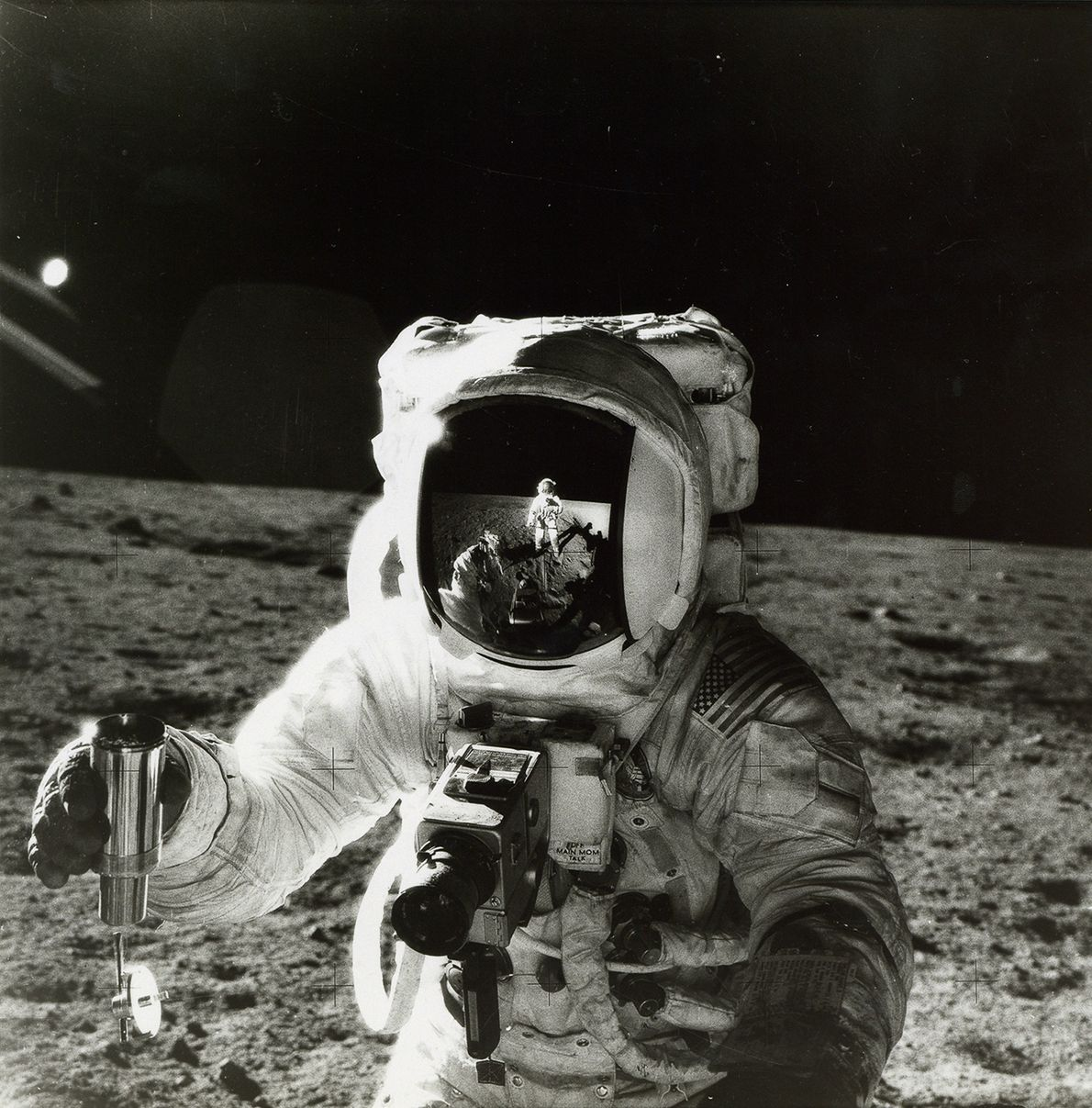 Astronaut Alan Bean holds a container of lunar soil in this 1969 photo from the Apollo 12 mission.